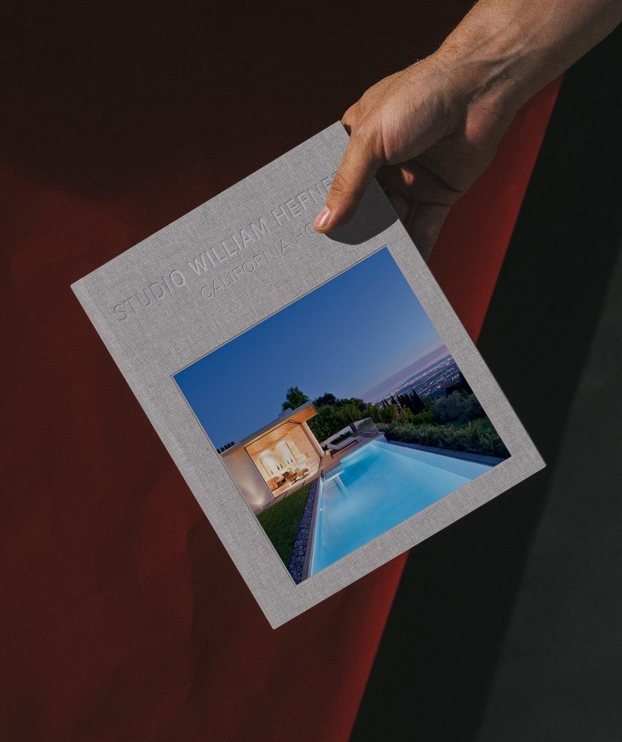 william_hefner_books_3-holding-book-california-homes-II